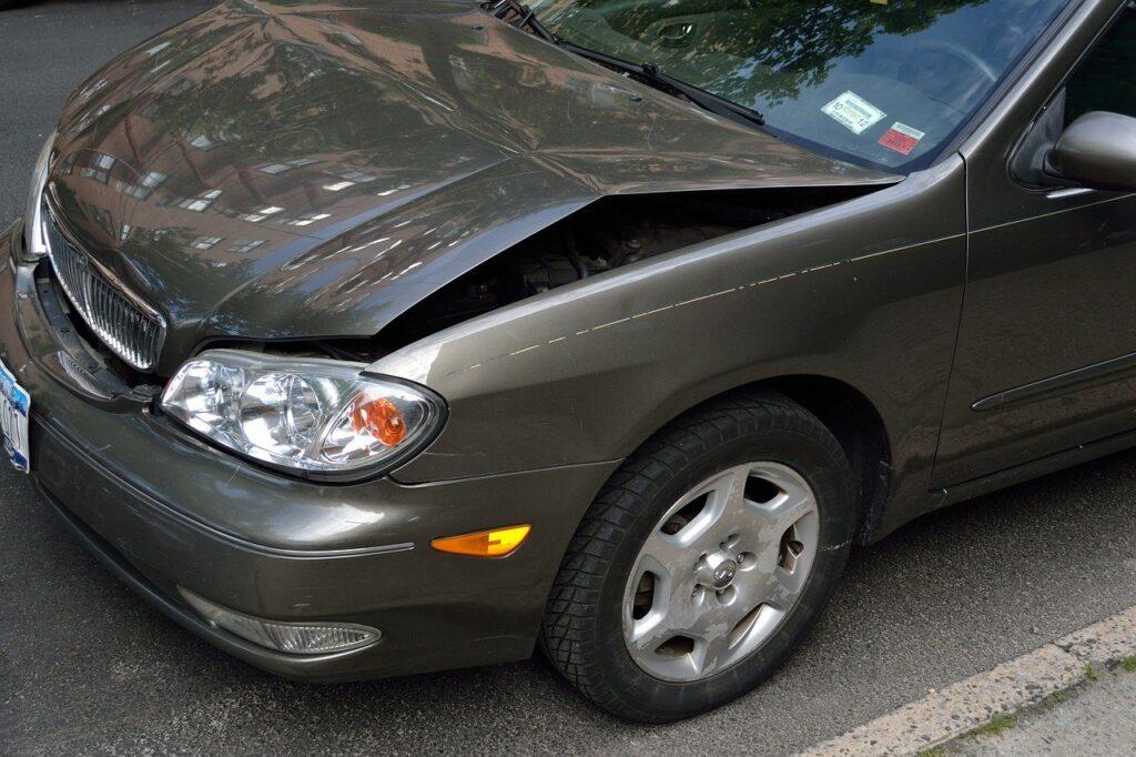 crashed car, damage, dent